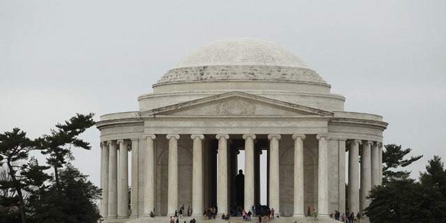 The Jefferson Memorial is seen on the Tidal Basin in Washington, March 18, 2012.   REUTERS/Gary Cameron   (UNITED STATES) - RTR2ZJUZ