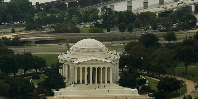 The Jefferson Memorial is surrounded by the Tidal Basin (bottom), and the Potomac River (top) in Washington October 1, 2014. Photograph taken from atop the Washington Monument.  REUTERS/Gary Cameron    (UNITED STATES) - RTR48Q3E