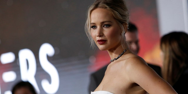 """Cast member Jennifer Lawrence poses at the premiere of """"Passengers"""" in Los Angeles, California U.S., December 14, 2016."""