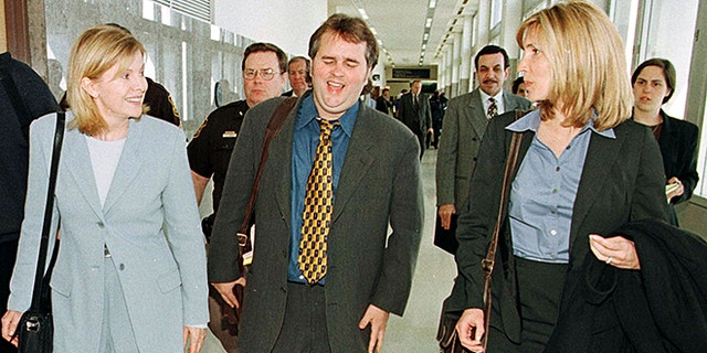 """Talk show host Jenny Jones, left, leaving the courtroom at Oakland County Courthouse in Pontiac, Michigan, April 12, 1999, with Ed and Debby Glavin, executive producers for """"The Jenny Jones Show."""""""