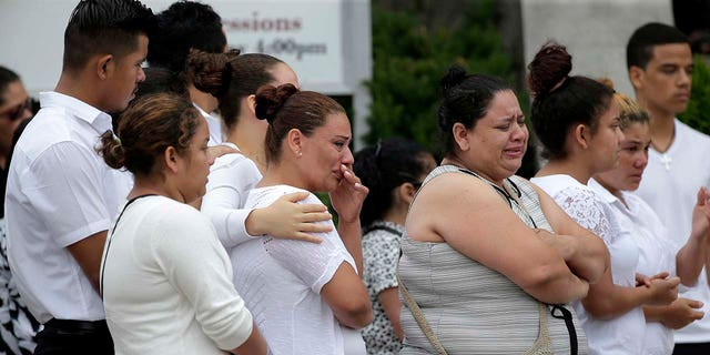Mourners gather outside a church in Union City, N.J., after a funeral for five children who were killed in a fire, July 25, 2018.