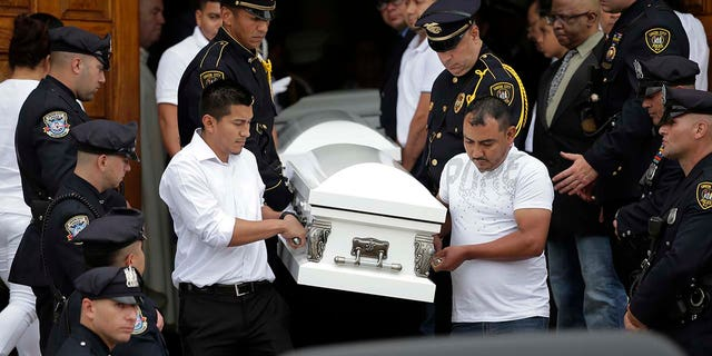 Five caskets are carried out of the church during a funeral for five children in Union City, N.J., Wednesday, July 25, 2018.