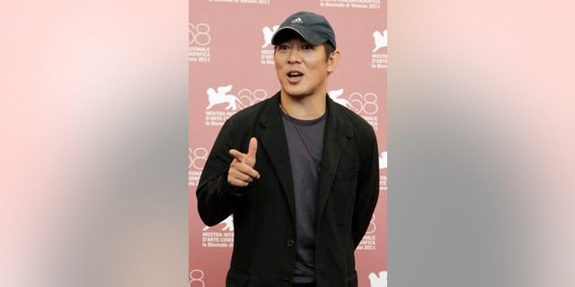 """September 2, 2011. Actor Jet Li poses during the photo call of film """"Baishe Chuanshuo"""" by director Ching Siu-Tung during the 68th Venice Film Festival."""