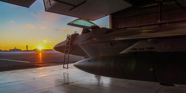 A US Air Force F-22 Raptor in a hangar at  Joint Base Elmendorf Richardson.