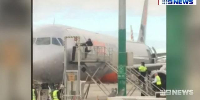 The man made it past crew after assaulting multiple Jetstar employees, then tried prying open the door to a Sydney-bound aircraft.