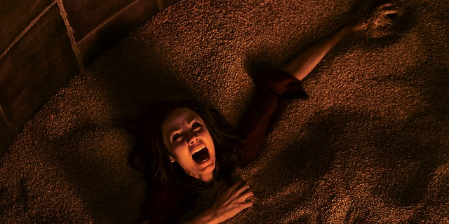 """This image released by Lionsgate shows Laura Vandervoort in the horror film, """"Jigsaw."""" (Brooke Palmer/Lionsgate via AP)"""