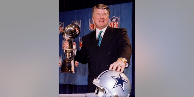 Coach Jimmy Johnson holds the Lombardi Trophy after the Dallas Cowboys won Super Bowl XXVIII.