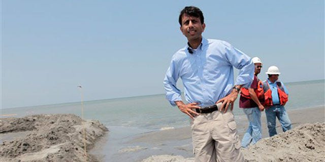 Louisiana Gov. Bobby Jindal looks over the berm system on the northern end of the Chandeleur Islands, La., July 15. (AP Photo)