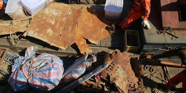 Workers transfer artifacts found from the long-lost warship Jingyuan in the sea area of Zhuanghe on September 25, 2018 in Dalian, Liaoning Province of China.