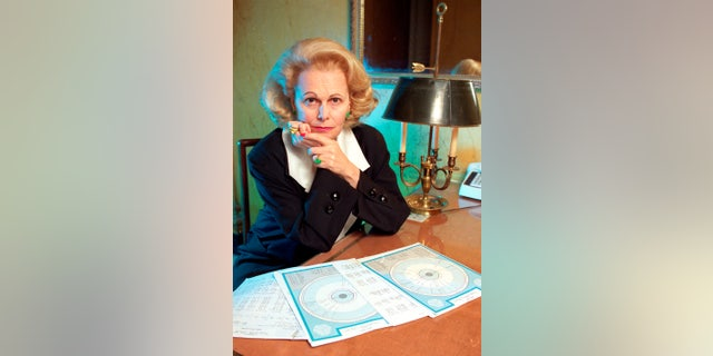 March 15, 1990, astrologer Joan Quigley is seen with charts she uses in her work at her residence in San Francisco.
