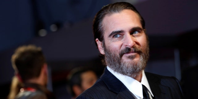 """Joaquin Phoenix arrives for UK premiere of """"You were never really there"""" during the British Film Institute (BFI) London Film Festival at Leicester Square in London, Britain, October 14, 2017.  REUTERS/Luke MacGregor - RC18AFFEB6F0"""