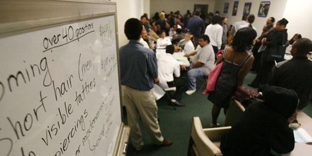 Applicants wait at a job fair in Los Angeles Nov. 20. (Reuters Photo)