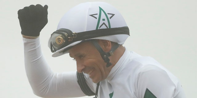 Jockey Mike Smith aboard Justify celebrates after winning the 143rd running Preakness Stakes at Pimlico Race Course.