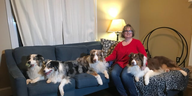 Jodie Strait and her dogs Memphis, Bumble Bee, Bacon, Stinger (from left to right)