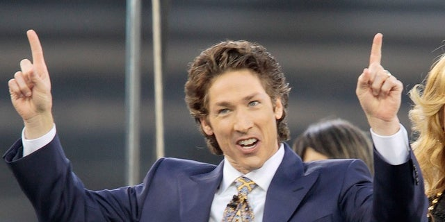 "FILE - This April 24, 2010 file photo shows Lakewood Church pastor Joel Osteen at Dodger Stadium during his ""A Night of Hope"" in Los Angeles. Osteen said in a statement to ABC News on Aug. 28, 2017, that his Lakewood Church would open as a shelter for Hurricane Harvey victims if needed. (AP Photo/Richard Vogel, File)"