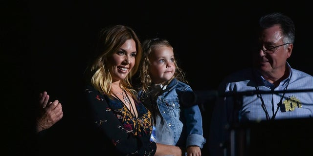 """Billy Joel's wife, Alexis Roderick, and their 2-year-old daughter Della Rose Joel joined the """"Piano Man"""" singer onstage."""
