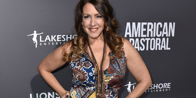 """In this Oct. 13, 2016 file photo, actress Joely Fisher arrives at a special screening of """"American Pastoral"""" in Beverly Hills, Calif. William Morrow, an imprint of HarperCollins Publishers said Thursday, April 27, 2017, that it had acquired her memoir """"Growing Up Fisher"""" and would release it November 14."""