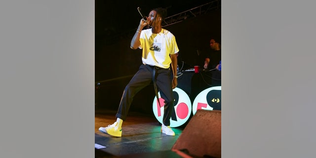 Rapper Joey Badass performs on stage at the Pier Six Concert Pavilion on Thursday, Aug. 10, 2017, in Baltimore. (Photo by Brent N. Clarke/Invision/AP)