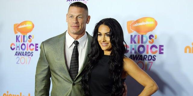 2017 Kids' Choice Awards - Arrivals - Los Angeles, California, U.S., 11/3/2017 - Show host John Cena and Nikki Bella. REUTERS/Mike Blake - RTX30MJH