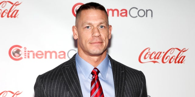 John Cena, recipient of the Action Star of the Year Award, poses on the red carpet during CinemaCon, a convention of movie theater owners, in Las Vegas, Nevada, U.S., March 30, 2017. Picture taken March 30, 2017. REUTERS/Steve Marcus - RTX33HJQ