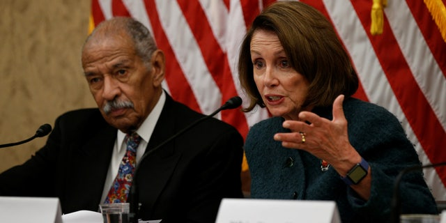House Minority leader Nancy Pelosi and Rep. John Conyers take part in a discussion panel.
