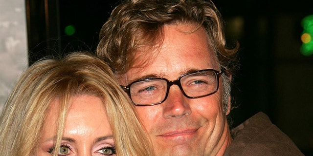John Schneider, right, and his wife Elvira Castle during happier times.