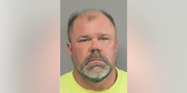 """John Patton, 54, is accused of luring an unidentified woman he met on the dating website """"Plenty of Fish"""" to his home and attempting to rape her."""