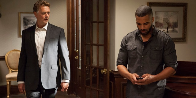 """John Schneider, left, and Tyler Lepley in a scene from Season 4 of Tyler Perry's """"The Haves and the Have Nots."""""""