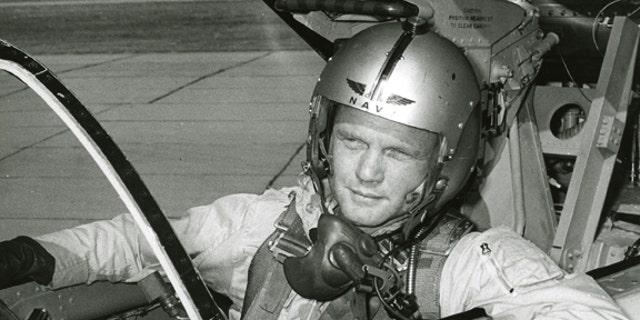 John Glenn in the cockpit the F8U-1P Crusader aircraft.