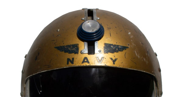The U.S. Navy helmet worn by John Glenn will be auctioned on May 31.