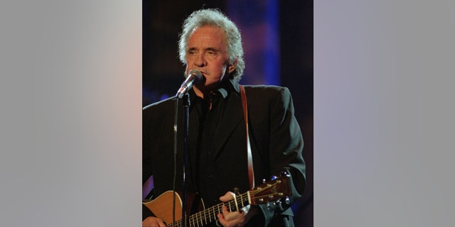 Sept. 2, 1995. Johnny Cash performs during his segment of the Concert for the Rock and Roll Hall of Fame in Cleveland.