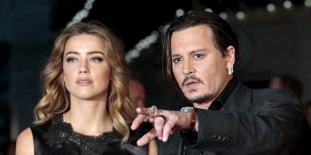 """Cast member Johnny Depp and his actress wife Amber Heard arrive for the premiere of the British film """"Black Mass"""" in London, Britain October 11, 2015. REUTERS/Suzanne Plunkett/Files     TPX IMAGES OF THE DAY      - RTSFY2G"""