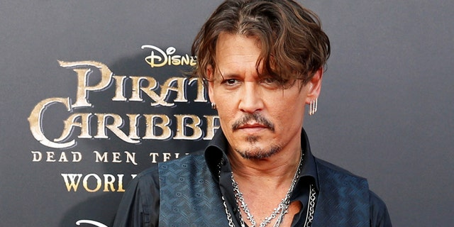 "Actor Johnny Depp arrives on the red carpet for the global premiere of the film ""Pirates of the Caribbean: Dead Men Tell No Tales"", in Shanghai, China May 11, 2017."