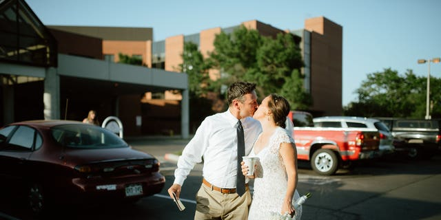 The bride and groom leaving the hospital.