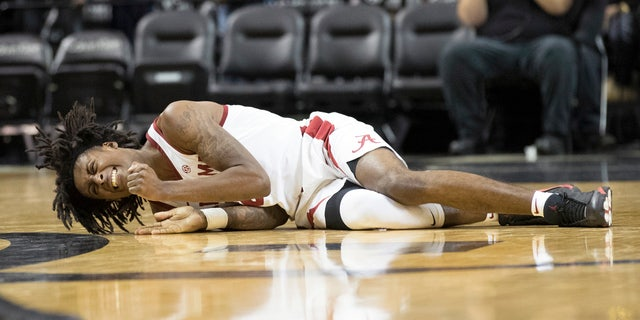 Alabama's John Petty reacts after suffering an ankle injury in the second half of Saturday's game.