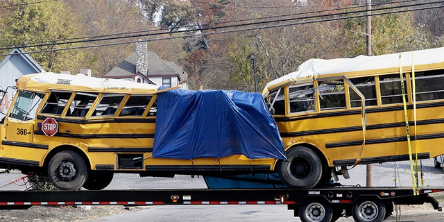 A school bus is carried away on a trailer after a deadly crash in Chattanooga, Tenn. that killed six elementary school students. (AP Photo/Mark Humphrey, File)