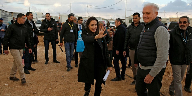 Actor Angelina Jolie, UNHCR Special Envoy, walks during her visit Al Zaatri refugee camp, in the Jordanian city of Mafraq, near the border with Syria, January 28, 2018. REUTERS/Muhammad Hamed - RC1C93A37CC0