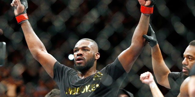 This Jan. 3, 2015, file photo shows Jon Jones celebrates after defeating Daniel Cormier during their light heavyweight title mixed martial arts bout in Las Vegas.