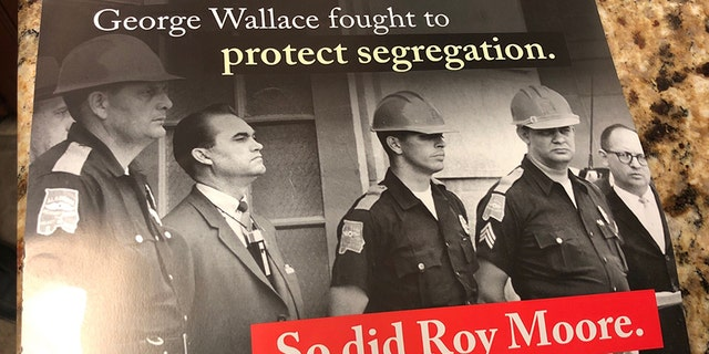 A mailer for Alabama Senate Democratic nominee Doug Jones compared Republican opponent Roy Moore to the former segregationist governor George Wallace.