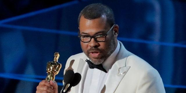 "90th Academy Awards - Oscars Show - Hollywood, California, U.S., 04/03/2018 - Jordan Peele accepts the Oscar for Best Original Screenplay for ""Get Out."" REUTERS/Lucas Jackson - HP1EE350A7AZK"