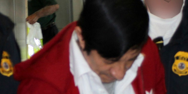 Jorge Sosa, a former Guatemalan soldier, as he is extradited to Los Angeles from Canada on Sept. 21, 2012.