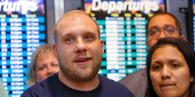 Josh Holt returned home with his wife, Thamara Candelo, on Monday after spending nearly two years in a Venezuelan jail.