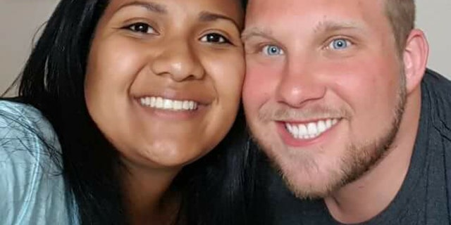 Thamara Caleño, left, and her husband, Joshua Holt.