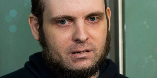 Joshua Boyle speaks to the media after arriving at the Pearson International Airport in Toronto in October. The former Afghanistan hostage will undergo a comprehensive psychiatric assessment after a court appearance in Ottawa Friday.