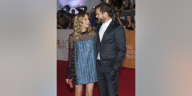 """Diane Kruger arrives with her boyfriend Joshua Jackson on the red carpet for the film """"Disorder"""" during the 40th Toronto International Film Festival in Toronto, Canada, September 17, 2015. TIFF runs from September 10-20.   REUTERS/Mark Blinch  - RTS1NK6"""