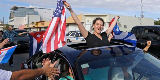 Cuban-Americans react to the death of Fidel Castro, Saturday, Nov. 26, 2016, in the Little Havana area in Miami.