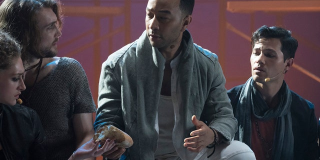 "JESUS CHRIST SUPERSTAR LIVE IN CONCERT -- ""Promo Shoot"" -- Season: 2018 --  Pictured: (l-r) Ensemble, John Legend as Jesus Christ, Jason Tam as Peter -- (Photo by: Virginia Sherwood/NBC)"