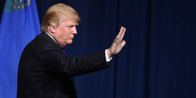 """LAS VEGAS, NV - FEBRUARY 23:  Republican presidential candidate Donald Trump waves after speaking at a caucus night watch party at the Treasure Island Hotel & Casino on February 23, 2016 in Las Vegas, Nevada. The New York businessman won his third state victory in a row in the """"first in the West"""" caucuses.  (Photo by Ethan Miller/Getty Images)"""