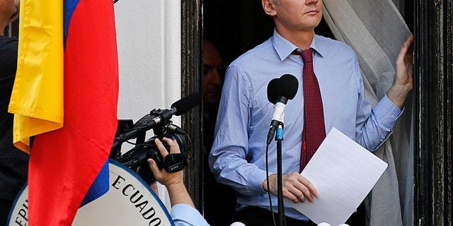 Wikileaks founder Julian Assange arrives to speak from the balcony of Ecuador's embassy, where he is taking refuge in London August 19, 2012.