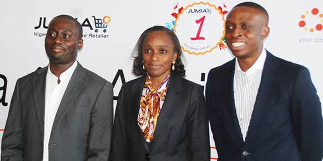Rapheal Afeador (left) and Tunde Kehinde (right), co-founders and managing directors of Jumia, flank Omobola Johnson, Nigeria's minister of communications and technology, at the first e- commerce conference in Nigeria.
